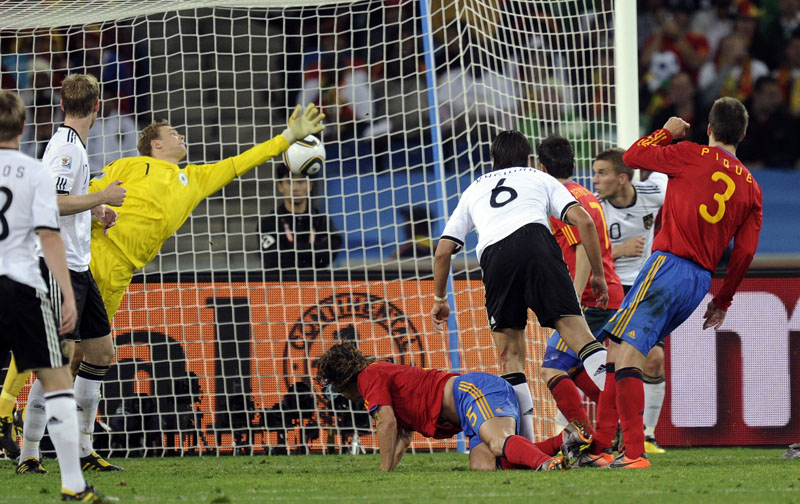 Spain's Carles Puyol, center, on the ground, scores the winning goal past Germany's goalkeeper Manuel Neuer, third left, during the World Cup semifinal today.