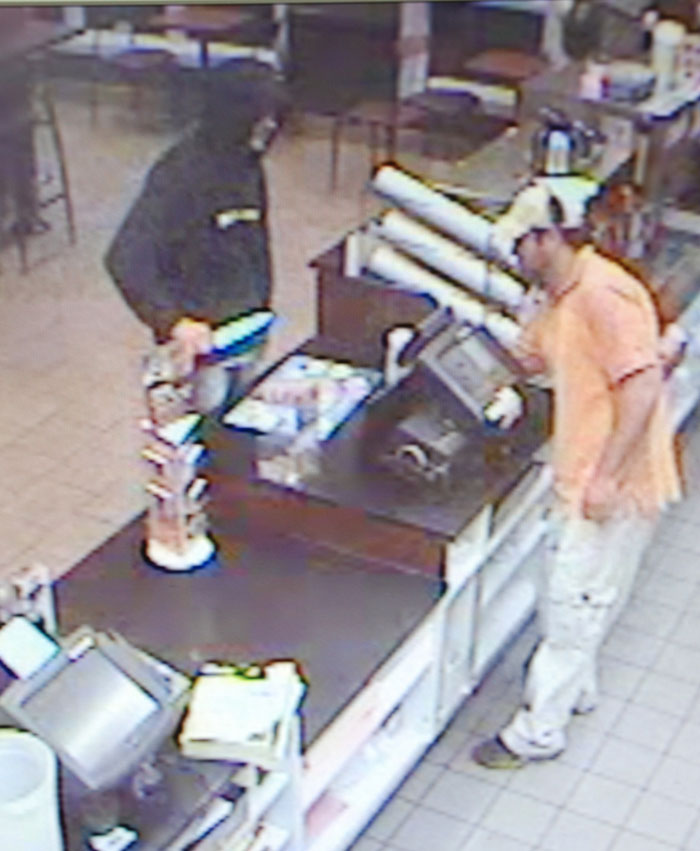 A security camera image taken Monday night at the Dunkin Donuts in Westbrook shows the robbery suspect wielding a knife and demanding money.