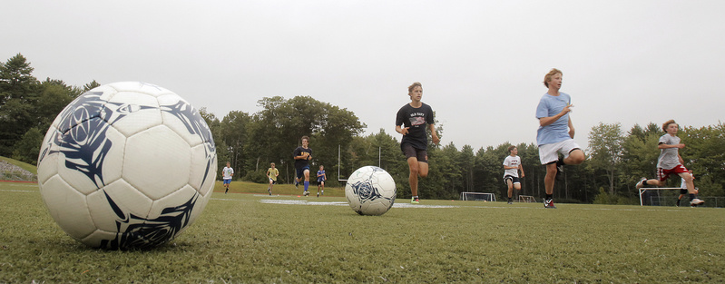 Candidates for the Yarmouth boys' soccer team run sprints during their opening day of practice.