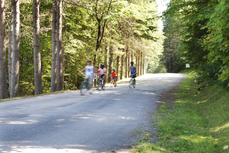 Children enjoy the traffic-free road at Aroostook State Park in Presque Isle, Maine's northern-most state park, and the state's first.