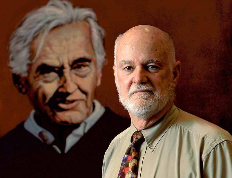 Charlie Clements, director of the Carr Center for Human Rights Policy at Harvard's Kennedy School, stands in front of a painting of historian Howard Zinn by artist Robert Shetterly of Brooksville.