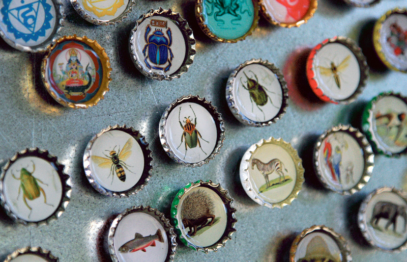 Magnets made with recycled bottle caps are displayed at the booth of Romona & Beatrice during the Picnic Music + Arts festival at Lincoln Park in Portland on Saturday.