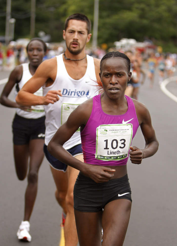 Lineth Chepkurui set a new women's course record with a time of 30 minutes, 59.4 seconds in the TD Bank Beach to Beacon 10K road race today.