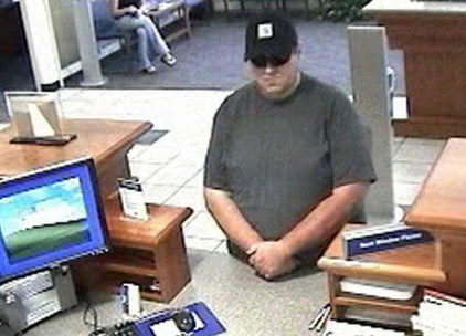 This July 13, 2010 security camera photo released by the Orono police shows Robert Ferguson, of Lowell, Mass., at Bangor Savings Bank in Orono.