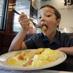 Seven-year-old Dominic Chiodo of Des Moines, Iowa, eats eggs benedict at a diner in Des Moines. Manager Shannon Vilmain said that more customers have been asking about the brand names of the eggs used and whether they're safe. It's right for consumers to be vigilant when it comes to food safety.