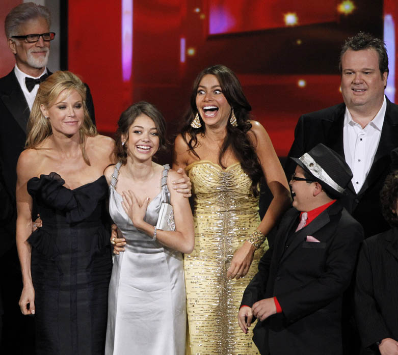 "The cast of ""Modern Family"" react as they accept the award for outstanding comedy series during the 62nd Primetime Emmy Awards Sunday in Los Angeles. From left are presenter Ted Danson, Julie Bowen, Sarah Hyland, Sofia Vergara, Rico Rodriguez and Eric Stonestreet."