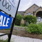 """A """"For Sale"""" sign is displayed outside a home in Springfield, Ill. Despite the lowest mortgage rates in decades, homes are quickly returning to their prewar status as places to live rather than sources of wealth."""