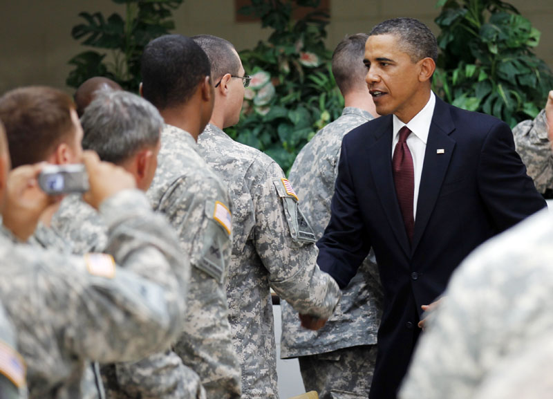 President Barack Obama greets members of the military at Fort Bliss in El Paso, Texas, today. Tonight, the president is to deliver a 15-20 minute speech in prime time from the Oval Office. His point is to mark Aug. 31, 2010, as the final day the U.S. led the war in Iraq after more than seven years.