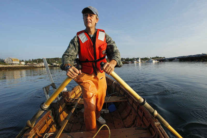 Lobsterman Nat Hussey rows out of the harbor on Matinicus Island.
