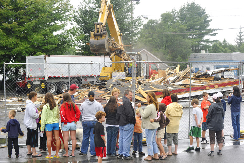 Neighbors and faithful customers of Red's in South Portland watch its demolition this morning.