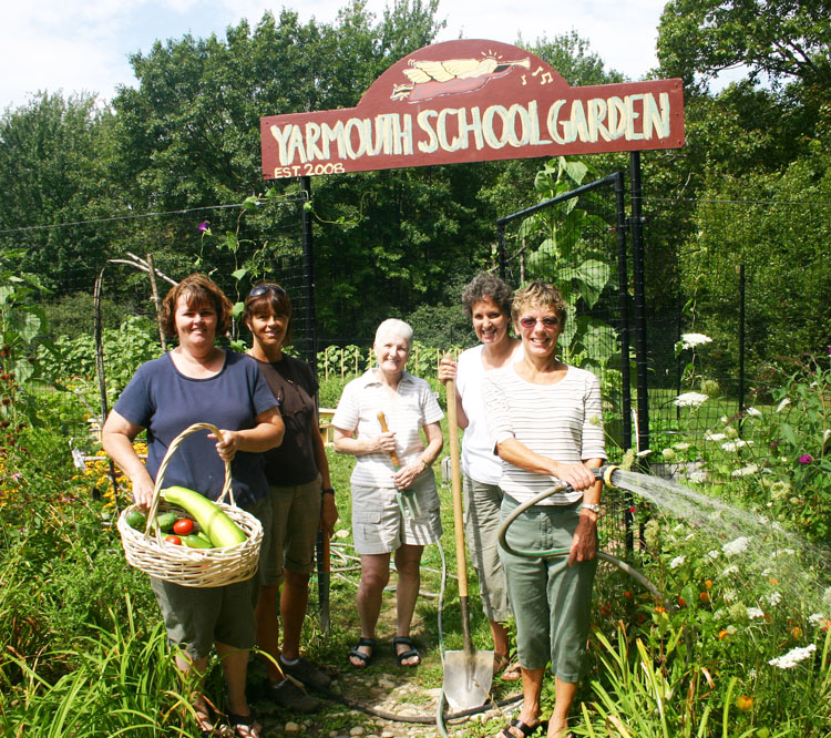 Yarmouth's nutrition director Becki Schreiber, with shovel, stands in the school district's garden with her coordinators, from left, Bertha Voss, who heads the high school kitchen, Barbara Pride, who handles the Rowe School kitchen, Linda Armstrong, who coordinates the middle school kitchen, and Susan Stowell, who heads the elementary school kitchen, where the garden is located.