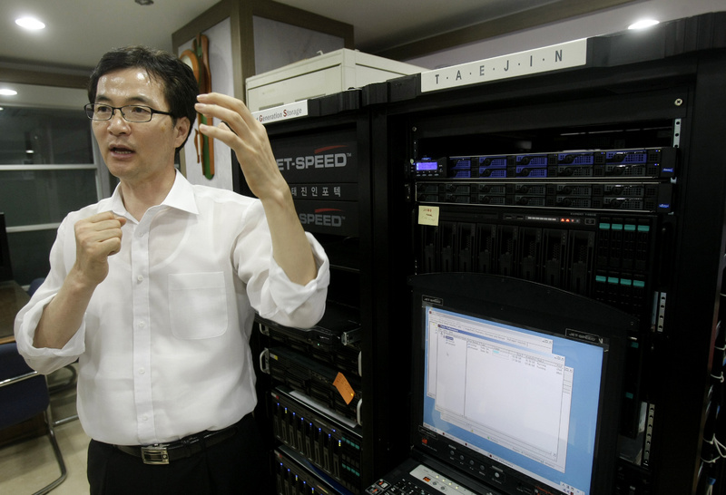 Cho Byung-cheol, president of Taejin Infotech Co., explains the use of a semiconductor-based high-speed data storage system at his office in Seoul, South Korea.