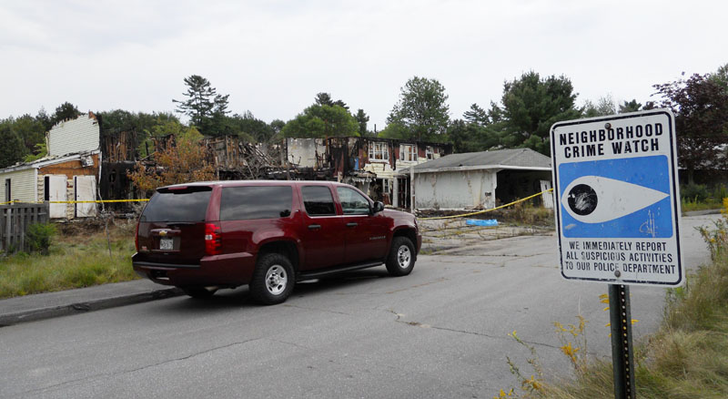 The apartment building (in background) at Brunswick Naval Air Station annex in Topsham that was destroyed in a fire earlier this month.