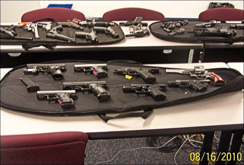 Guns recovered from a burglary on Saturday are displayed at the Winthrop Police Department on Tuesday. Police said they recovered all 34 guns stolen as well as the ammunition from the rooftop break-in at Audette's Hardware store in Winthrop.