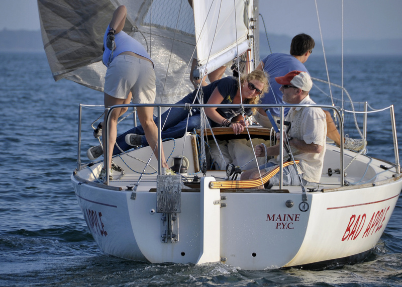Shannon Bryan ducks under the boom as the Bad Apple, skippered by Bruce Morse, tacks during a Wednesday J-24 sailboat race out of Portland Yacht Club.