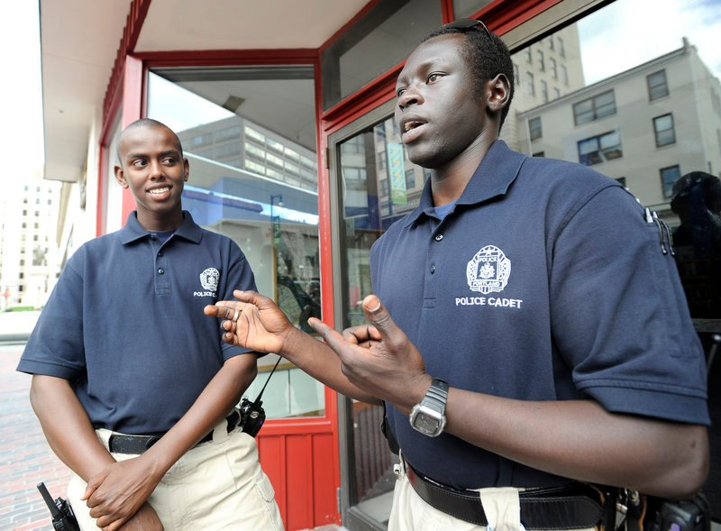 Iman Ali, left, and Ater Ater are members of Portland's Police Explorers, a group allied with the Boy Scouts of America. In helping police reach out to immigrant communities, it is a benefit that Ali speaks Somali while Ater speaks the Sudanese language Dinka.