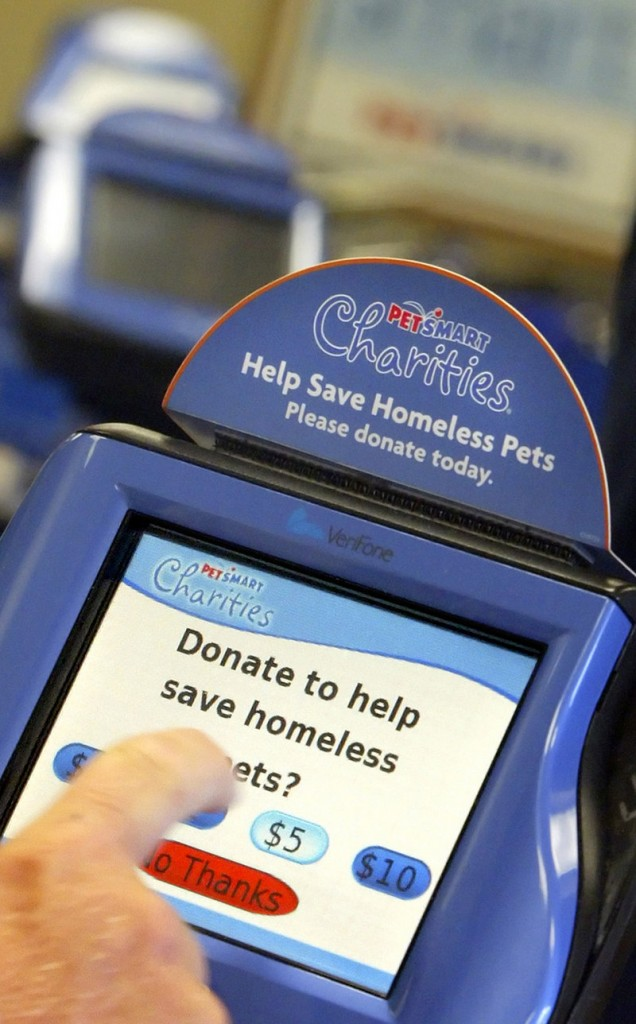 PetSmart, like many retailers, prompts customers for donations to its charities year-round. Here, a customer donates $5 to a program for stray animals.