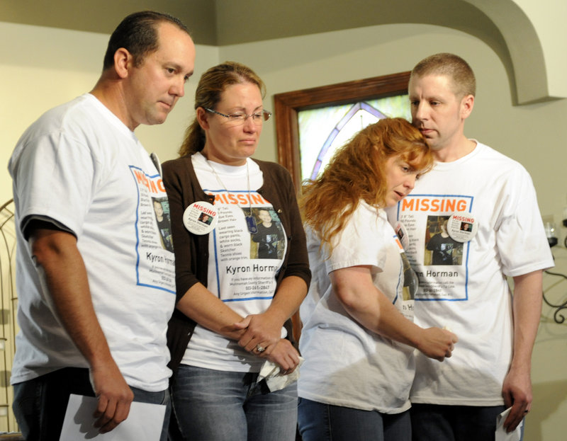 The family of missing 7-year-old Kyron Horman are, from left, Tony Young; the boy's mother, Desiree Young; Terri Horman, the boy's stepmother; and the boy's father, Kaine Horman. They are shown together in June, before several bizarre twists.