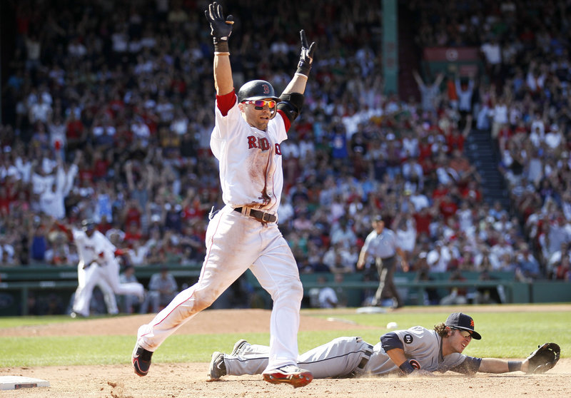 Marco Scutaro celebrates his bunt single, which drove in Darnell McDonald, with the winning run scoring on a throwing error by Detroit pitcher Robbie Weinhardt that second baseman Willie Rhymes failed to handle. Boston won, 4-3.