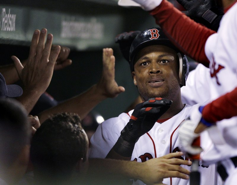 Adrian Beltre is all smiles in the Red Sox dugout after hitting a three-run homer in the eighth inning Monday night. His second homer of the game made it a one-run game, but the Sox ended up losing to the Indians, 6-5.
