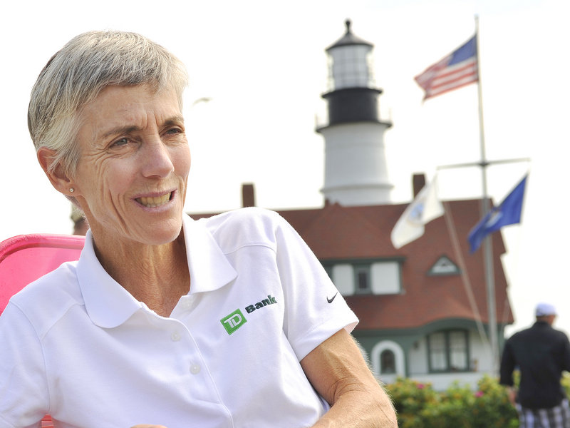 Joan Benoit Samuelson, founder of the Beach to Beacon road race, talks about Saturday's event near the finish line at Portland Head Light.