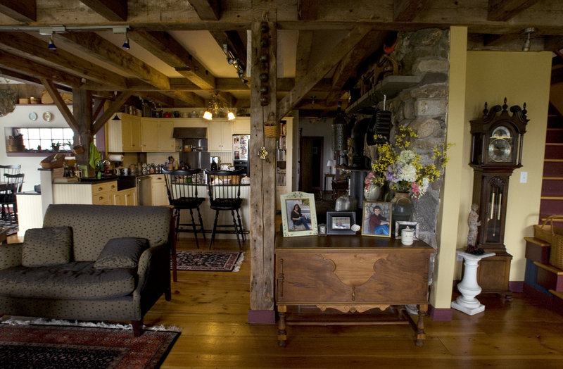 Old beams grace an open yet cozy living area.