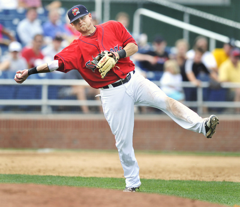 Ryan Khoury, the Sea Dogs' third baseman, makes an off-balance throw after fielding a slow grounder behind the mound during a 4-3 loss against Bowie on Thursday at Hadlock Field.