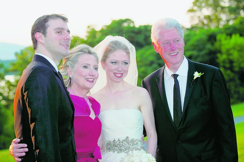 Marc Mezvinsky, left, poses with his mother-in-law, Hillary Clinton, his bride, Chelsea, and his father-in-law, former President Clinton, after the ceremony in Rhinebeck, N.Y., on July 31. Mezvinsky is Jewish; his wife is a Methodist.