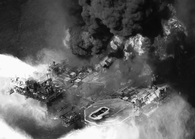 Aerial photo taken April 21 shows the Deepwater Horizon oil rig burning in the Gulf of Mexico more than 50 miles southeast of Venice, La. Authorities are turning their attention to gathering evidence from what resembles a crime scene at the bottom of the sea.
