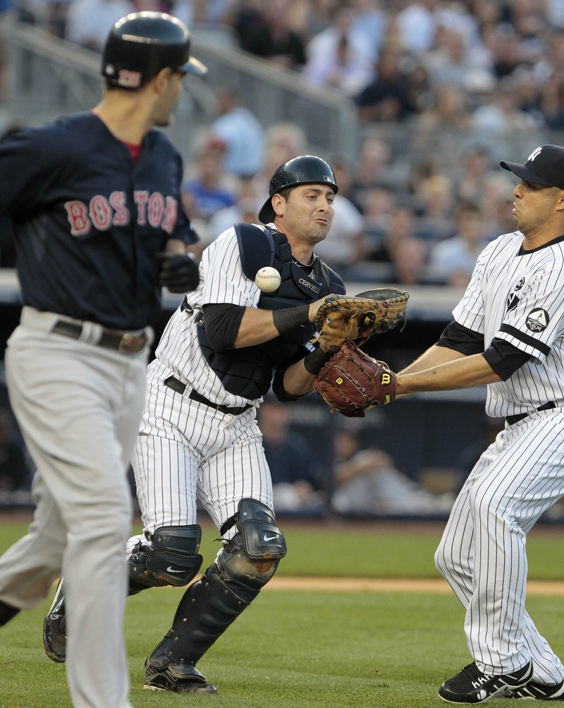Yankees catcher Francisco Cervelli loses Mike Lowell's pop fly in the second inning Friday night – a key play in a 6-3 victory for the Red Sox.