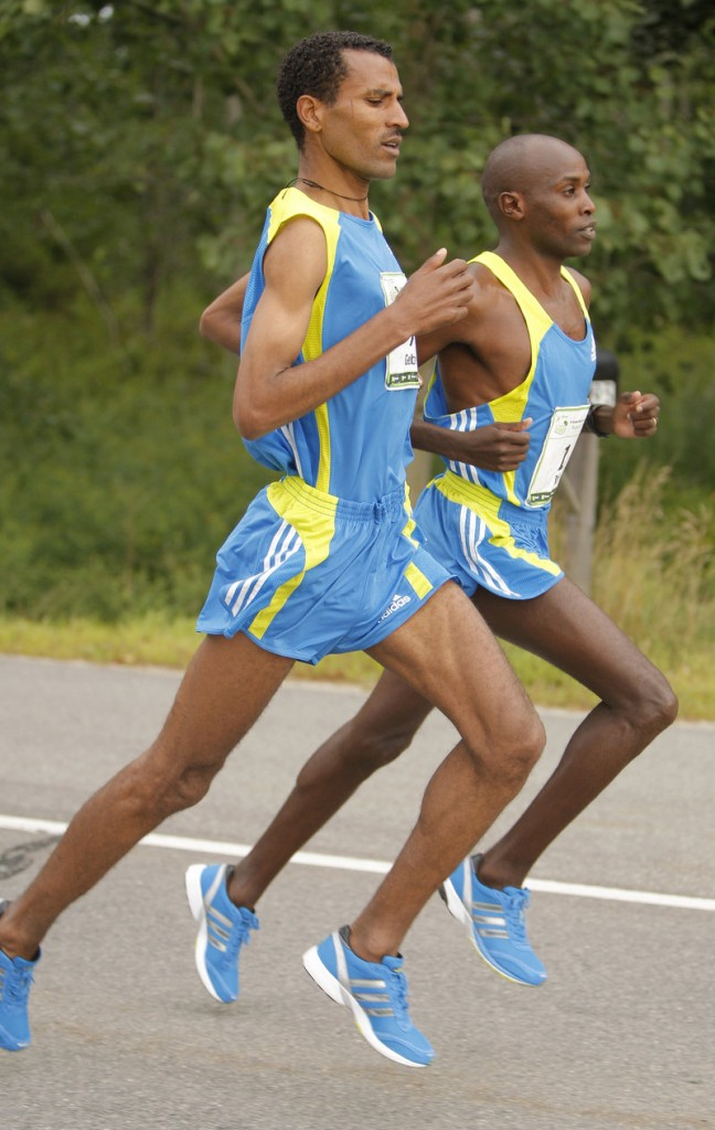 Beach to Beacon winner Gebre Gebremariam, left, runs shoulder to shoulder with two-time defending champ Ed Muge. Muge finished fifth.