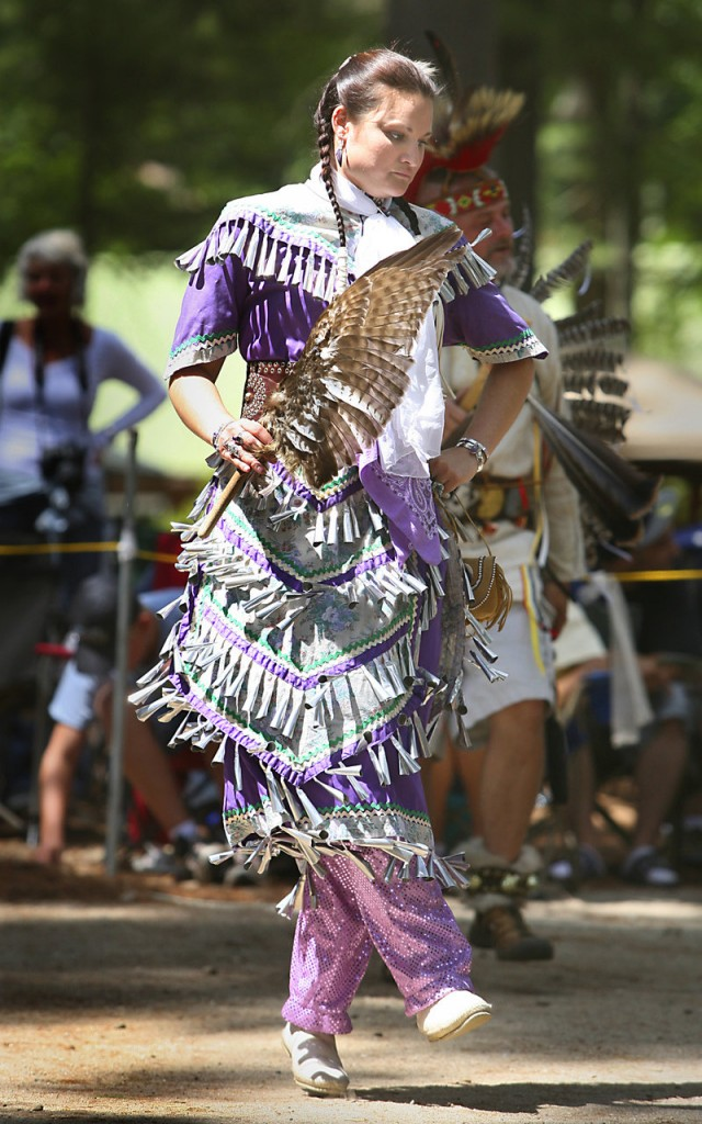 Stacy Jenness of Farmington, N.H., joins in an intertribal dance.