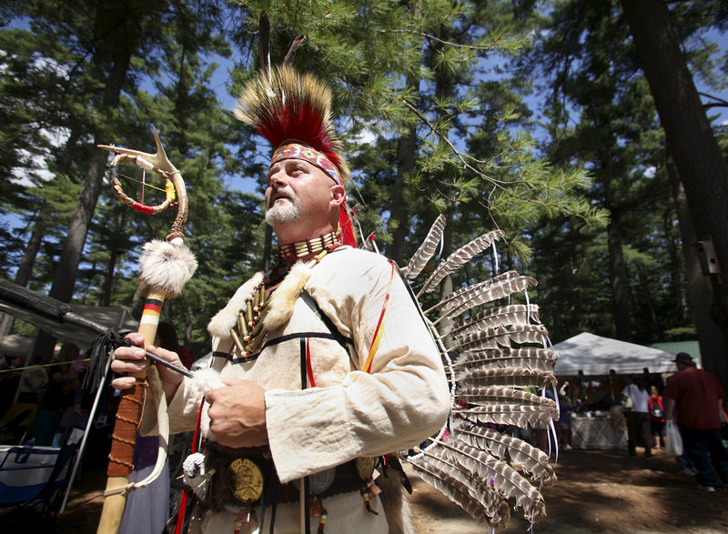 George Castonguay of Jay enters the dance ring during the Grand Entry at the powwow, which continues today.