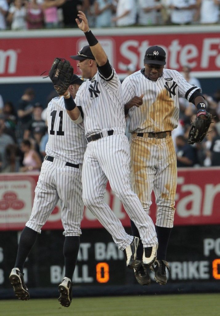 Celebration time for the New York Yankees after a 5-2 victory Saturday against the Boston Red Sox. Nick Swisher, center, Brett Gardner, left and Curtis Granderson do the hop.