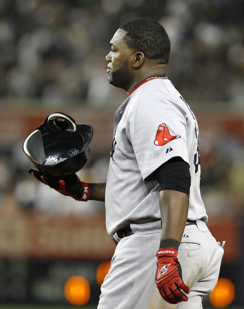 David Ortiz tosses his helmet after grounding out with the bases loaded for the final out in the top of the seventh inning Sunday night at Yankee Stadium. Boston wraps up the four-game series today.