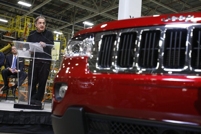 Chrysler CEO Sergio Marchionne introduces the 2011 Jeep Grand Cherokee, which came out in June and was the first new vehicle released after Fiat took over.