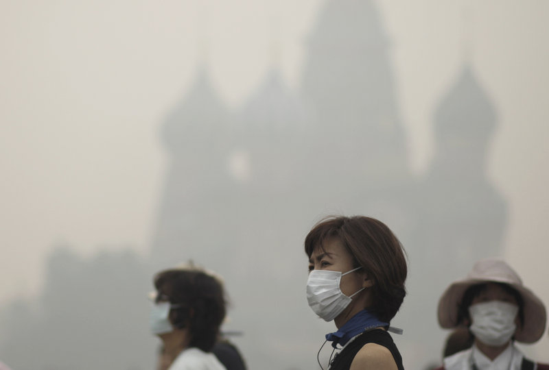 Tourists walk along Red Square in Moscow in a blanket of smog in 2014. China, Mexico, India and parts of Russia show how bad our environment could become.