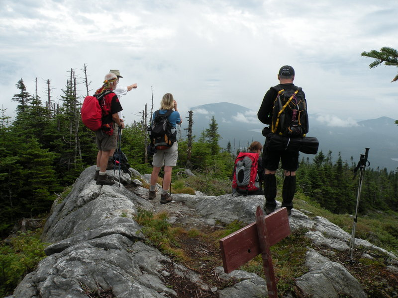 Hikers on the Sentiers Frontaliers look into Maine from Cap Frontiere. The trail crosses a series of 3,000-foot peaks.