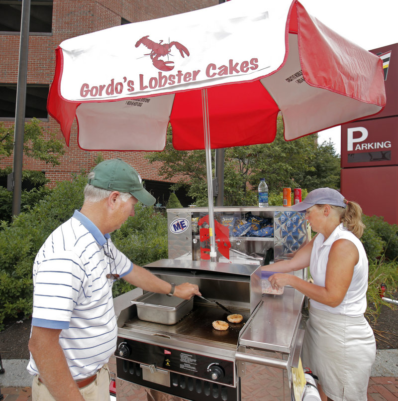 Gordon and Carolyn Smith started selling lobster cakes and lobster rolls from their cart on Commercial Street in Portland this summer. The 3 1⁄2-ounce lobster cakes are served hamburger-style.