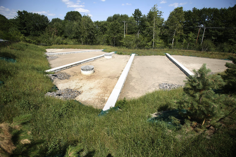 This sand filter behind Dick's Sporting Goods and the IRS office in South Portland allows stormwater to spread before soaking into a layer of soil, sand and mulch and another layer of stone product.