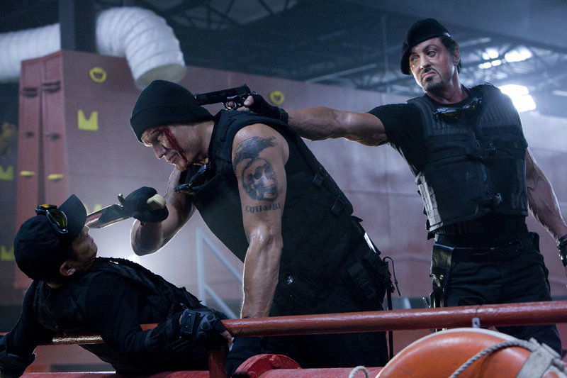 "Jet Li, left, Dolph Lundgren and Sylvester Stallone appear in ""The Expendables."""