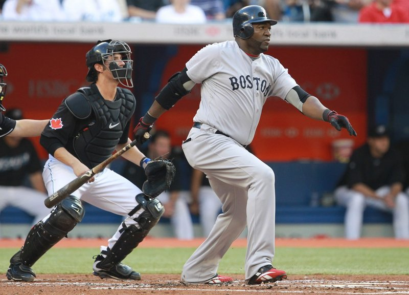 David Ortiz hits a double during the second inning Tuesday night against the Blue Jays in Toronto. The Red Sox won 7-5, collecting their eighth victory in their last 11 games on the road.