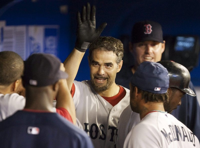 Mike Lowell celebrates his solo homer in the eighth inning Tuesday night in Toronto. The Red Sox defeated the Blue Jays, 7-5.