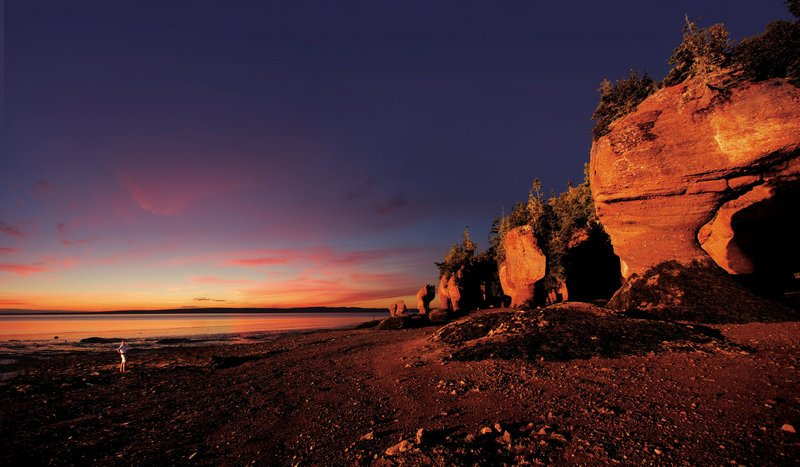 Enormous flowerpot-shaped formations at Hopewell Rocks along the Bay of Fundy in New Brunswick can be explored on foot at low tide and by kayak at high tide.