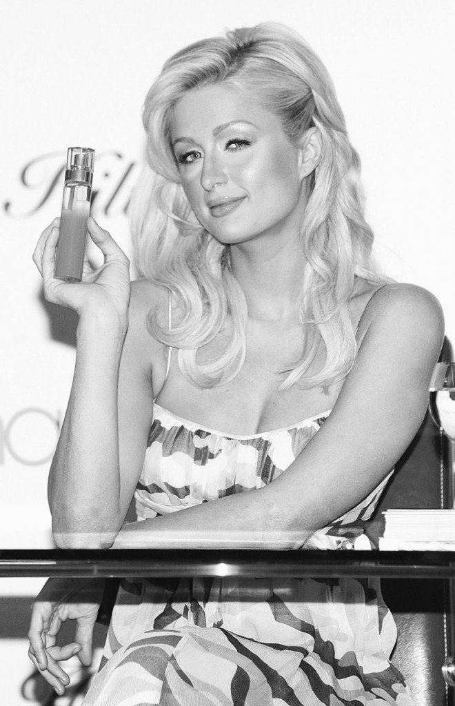 Paris Hilton holds her new fragrances, Just Me, during an appearance at Macy's Herald Square in New York in 2006. A company that makes hair extensions says she breached her promotional contract.