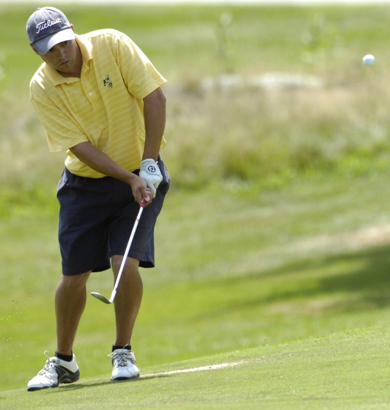 Joe Alvarez chips during his match against Mark Plummer on Thursday in the MSGA match play championship. Alvarez won the title by beating Plummer, 3 and 2.
