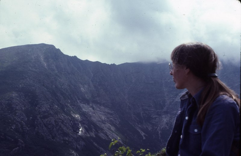 Susan Faust sits at Chimney Pond in Baxter State Park and gazes at the Knife Edge, a hiking trail on Mt. Katahdin, on her second wedding anniversary in July 1982.