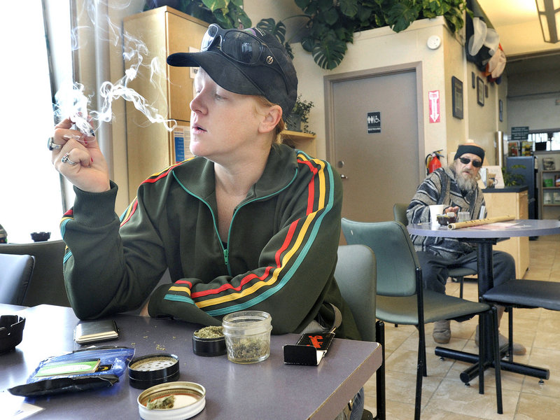 Emily Scarbrough smokes a joint at the Berkeley Patients Group clinic in Berkeley, Calif.