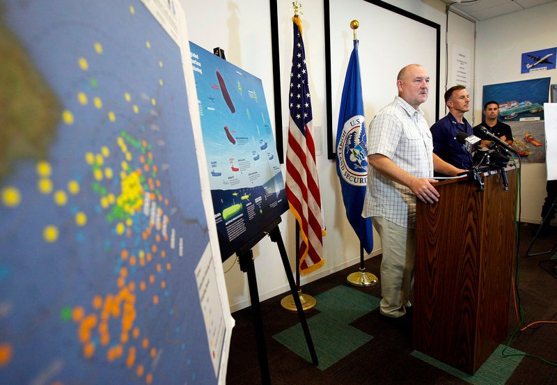"""""""The relief well will be finished,"""" retired Coast Guard Adm. Thad Allen, left, told reporters Friday in Schriever, La. In the foreground is a subsurface monitoring map of the Gulf."""