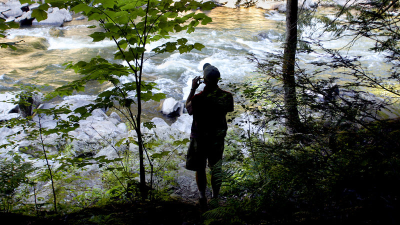 David Little of Portland photographs the Presumpscot River Falls during the Walk Along the Presumpscot Trail hosted by the Portland Trails as part of their Adventure Series in Portland on Friday.